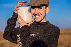 Happy smiling man with milk Royalty Free Stock Image