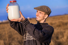 Happy smiling man with milk Stock Image