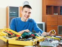 Happy smiling man organizing toolbox Royalty Free Stock Photos