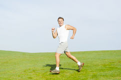 Happy smiling man running. Stock Photos