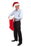 Happy Smiling Man in Santa Hat with Stocking Royalty Free Stock Photos