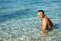 Happy smiling man in sea Stock Images