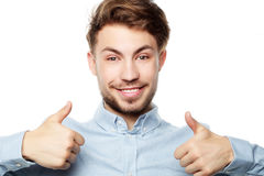 Happy smiling man showing thumb up hand sign on white background Royalty Free Stock Photo