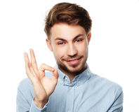 Happy smiling man showing thumb up hand sign on white background Stock Image
