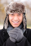 A happy smiling man wearing a fur hat Royalty Free Stock Images