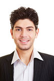 Happy smiling manager. Portrait of a young happy smiling manager Royalty Free Stock Photos