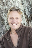 Happy smiling mature man with blond hair. A happy smiling mature man with blond hair looking at camera Royalty Free Stock Image