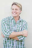 Happy smiling mature man in forties. Happy smiling mature man in forties with blond hair and blue eyes Stock Photo