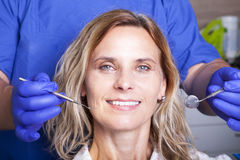 Happy smiling mature woman at dentist Royalty Free Stock Photo
