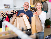 Happy smiling mature woman and man holding bags Stock Photo