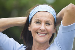 Happy smiling mature woman outdoor Stock Image