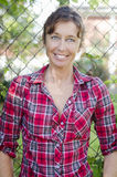 Happy smiling mature woman in red checked shirt Stock Photo