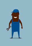 Happy smiling mechanic or repairman with wrench Stock Photo