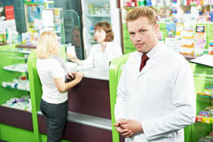 Happy smiling medical pharmacist or pharmacy worker royalty free stock image