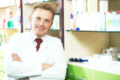 Happy smiling medical pharmacist or pharmacy worker stock photography