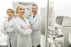 Happy smiling medical workers among equipment royalty free stock photos