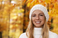 Happy smiling middle age woman with cap and scarf in front of au stock photo