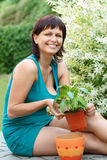 Happy smiling middle age woman gardening Royalty Free Stock Photography