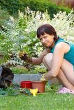 Happy smiling middle age woman gardening Royalty Free Stock Image