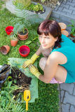 Happy smiling middle age woman gardening Royalty Free Stock Photo