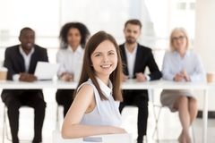 Happy smiling millennial applicant looking at camera at job inte stock images