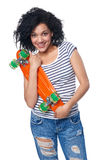 Happy smiling mixed race female in distressed jeans with skateboard Royalty Free Stock Image