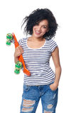 Happy smiling mixed race female in distressed jeans with skateboard Royalty Free Stock Images