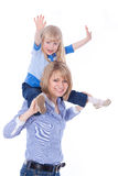 Happy smiling mom with child on shoulders Stock Photo