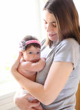 Happy smiling mother with baby Stock Images