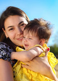 Happy smiling mother with baby Stock Photo