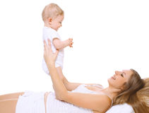 Happy smiling mother and baby having fun together Stock Photos