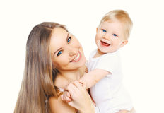 Happy smiling mother and baby having fun together on white Stock Photos