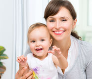 Happy Smiling Mother and Baby Royalty Free Stock Image