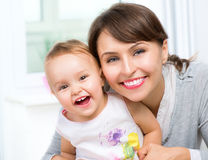 Happy Smiling Mother and Baby Stock Image