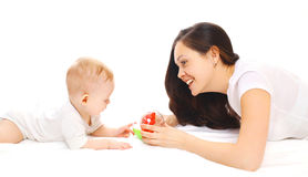 Happy smiling mother and baby playing in toys over white Stock Photo