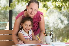 Happy Smiling Mother And Child Daughter Drawing Picture Royalty Free Stock Images