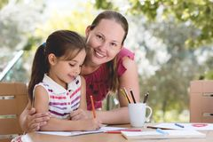 Happy Smiling Mother And Child Daughter Having Fun and Drawing P stock photo