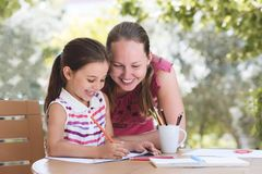Happy Smiling Mother And Child Daughter Having Fun and Drawing P stock image