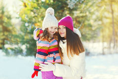 Happy smiling mother and child daughter in winter. Happy smiling mother and child daughter together in winter Royalty Free Stock Photos