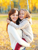 Happy smiling mother and child having fun together in autumn Stock Images