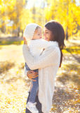 Happy smiling mother and child playing having fun in autumn Stock Photography
