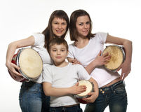 Happy smiling mother with children with drums Stock Photo