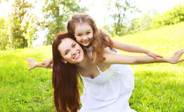 Happy smiling mother and daughter child having fun together Royalty Free Stock Photos