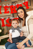 Happy smiling mother with daughter. Christmas time Stock Images