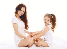 Happy smiling mother and daughter having fun Stock Photos