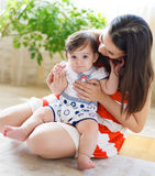 Happy smiling mother with eight month old baby Stock Photos