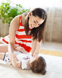 Mother with eight month old baby girl indoor Stock Photography