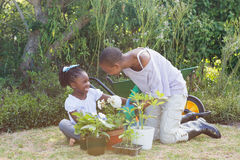 Happy smiling mother gardening with her daughter Royalty Free Stock Images