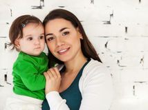 Happy smiling mother with her baby Stock Image