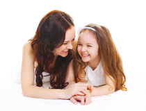 Happy smiling mother with little child daughter on white Stock Images